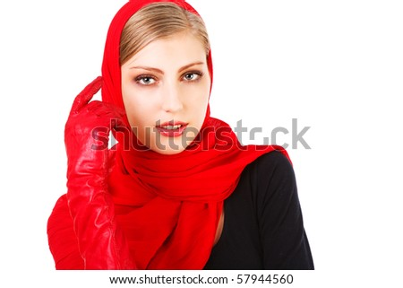 Portrait of a beautiful cute young girl in red scarf and gloves on white background - stock photo