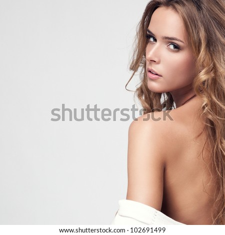 Portrait of a beautiful delicate woman - stock photo
