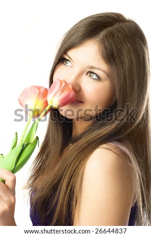 portrait of a beautiful dreamy girl with tulips in her hands - stock photo