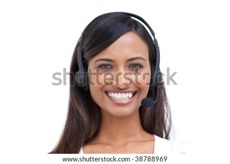 Portrait of a beautiful ethnic businesswoman with a headset on - stock photo