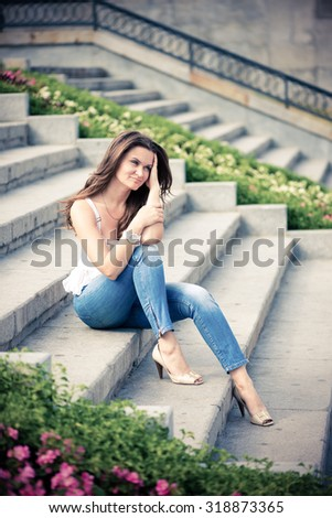 Portrait of a beautiful european woman sitting om steps