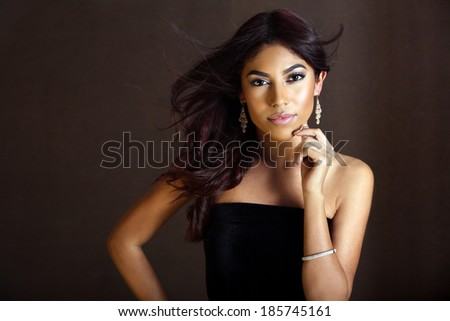 Portrait of a beautiful exotic woman - stock photo