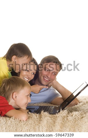 portrait of a beautiful family of four - stock photo