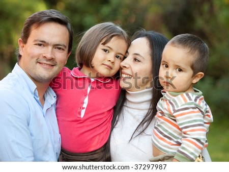 Portrait of a beautiful family outoors smiling