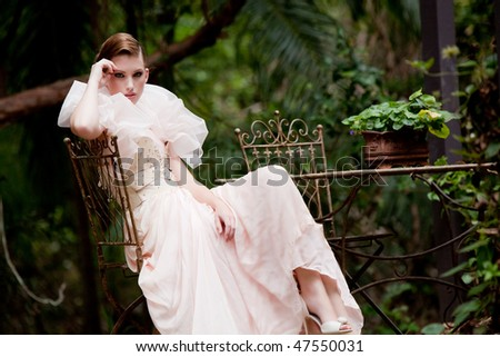 portrait of a beautiful fashion model wearing an elegant dress - stock photo
