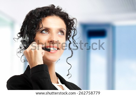 Portrait of a beautiful female call center operator - stock photo