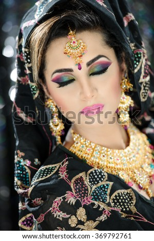Portrait of a Beautiful Female Model in makeup and fancy outfit - stock photo