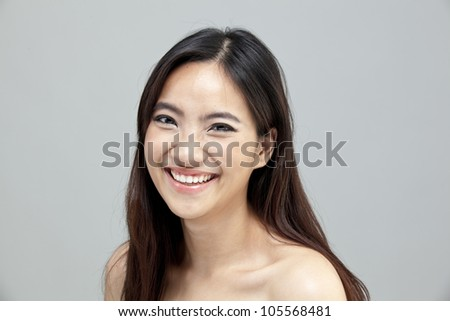 Portrait of a beautiful female model on isolated gray background