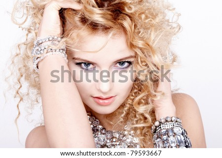 portrait of a beautiful female model on white background with diamond jewelry - stock photo