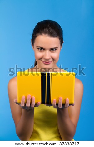 portrait of a beautiful female with a laptop