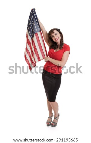 Portrait of a beautiful fit mid 40s woman holding a vintage American flag isolated on white - stock photo