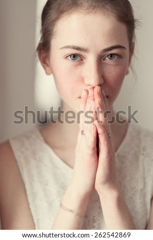 portrait of a beautiful girl embarrassed - stock photo