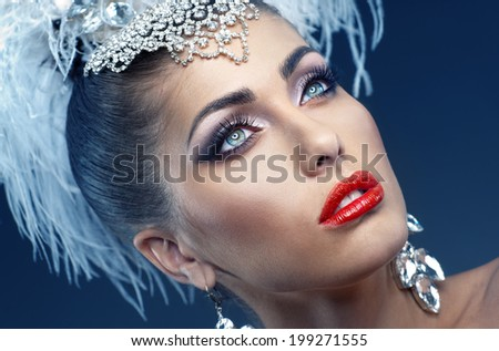 Portrait of a beautiful girl from a cabaret with feathers