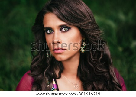 Portrait of a beautiful girl gypsy with green eyes - stock photo