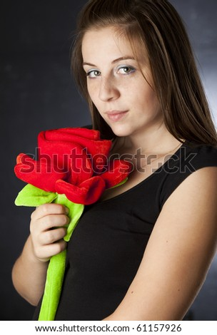 portrait of a beautiful girl holding a huge plush rose