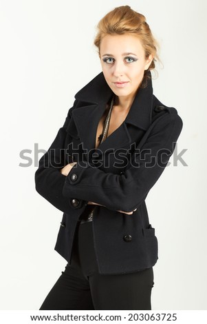 Portrait of a beautiful girl in a black suit - stock photo