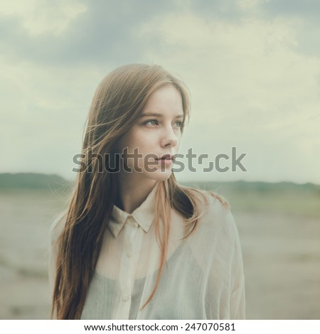 portrait of a beautiful girl in a blouse - stock photo