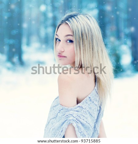 portrait of a beautiful girl in a cold park - stock photo