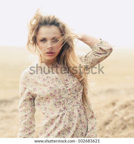 portrait of a beautiful girl in a field - stock photo