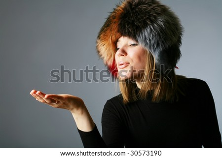 portrait of a beautiful girl in a fur hat