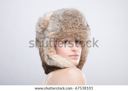 portrait of a beautiful girl in a fur russian hat - stock photo
