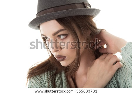 portrait of a beautiful girl in a hat with sexy lips vogue style
