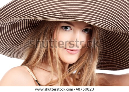 Portrait of a beautiful girl in a summer hat. Isolated over white background. - stock photo
