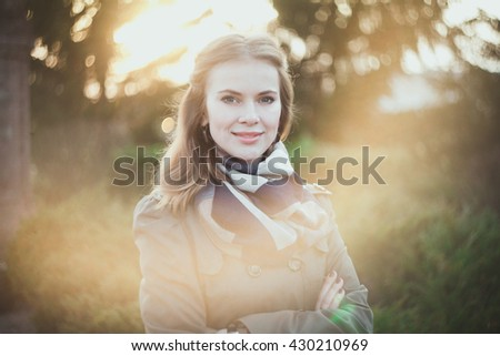 Portrait of a beautiful girl in a sunny spring park