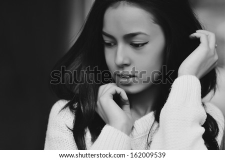 Portrait of a beautiful girl in black & white - stock photo