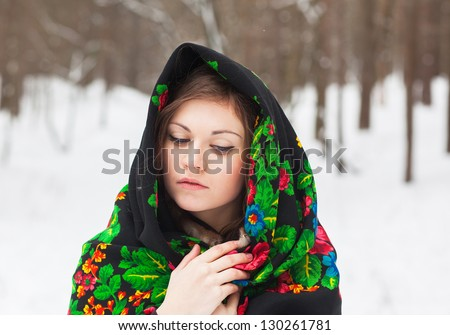 Portrait of a beautiful girl in cloth with patterns