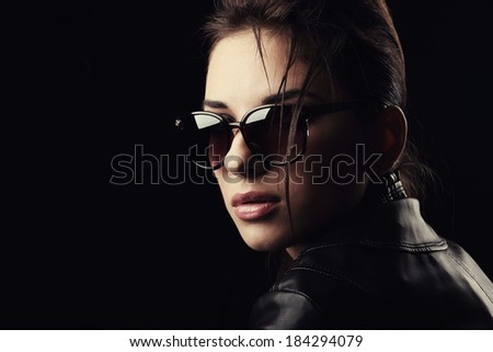 Portrait of a beautiful girl in glasses. - stock photo