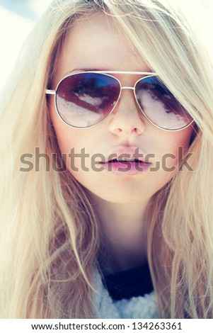 portrait of a beautiful girl in glasses close up - stock photo