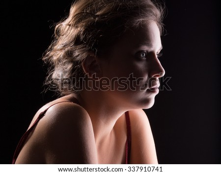 Portrait of a beautiful girl in side the light - stock photo