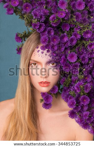 Portrait of a beautiful girl in the flowers