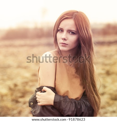 portrait of a beautiful girl in the park in autumn - stock photo