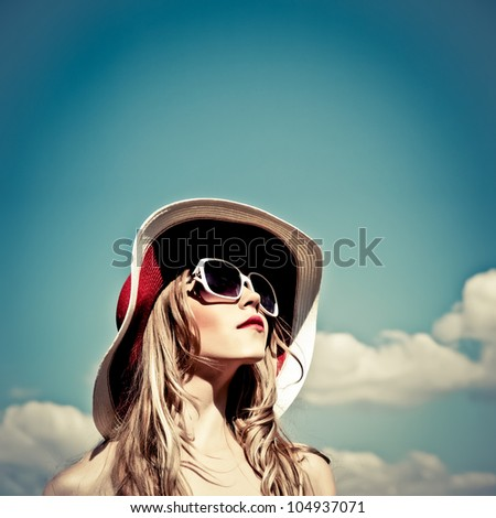 portrait of a beautiful girl in the sky - stock photo