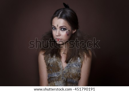 Portrait of a beautiful girl in the style of Indian America in a fur vest