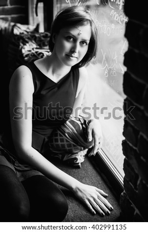 portrait of a beautiful girl in the vintage interior
