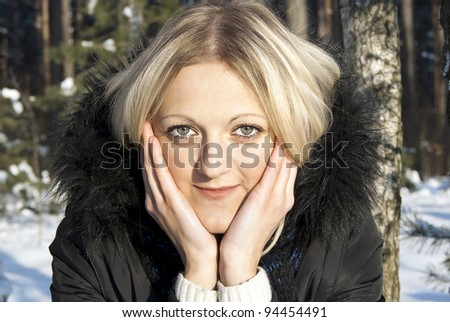 portrait of a beautiful girl in the winter in nature - stock photo