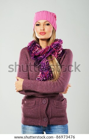 Portrait of a beautiful girl in warm clothing - stock photo