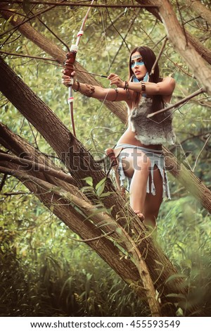 Portrait of a beautiful girl. Native american, Indian woman in traditional dress,posing in the wild forest.  - stock photo