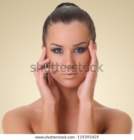 portrait of a beautiful girl. on a brown background - stock photo