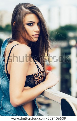 portrait of a beautiful girl on a city street. Outdoors, lifestyle - stock photo
