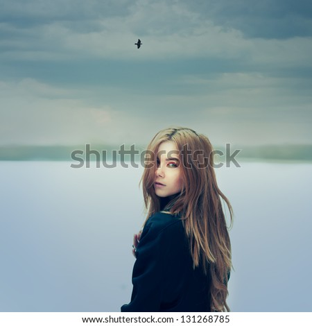 portrait of a beautiful girl on a cloudy day. Photo Gothic - stock photo