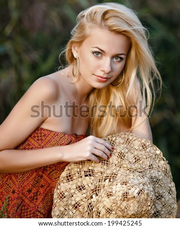 portrait of a beautiful girl on a summer evening sun - stock photo