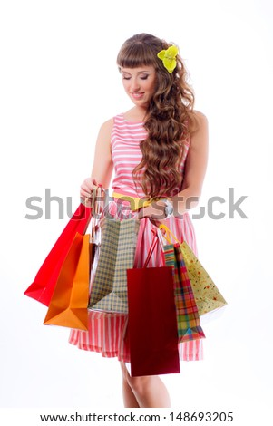 portrait of a beautiful girl on a white background with shopping bags