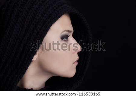 Portrait of a beautiful girl on black background - stock photo