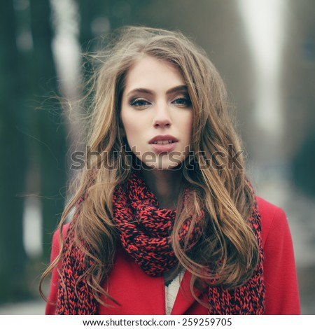 Portrait of a beautiful girl on cold windy day - stock photo