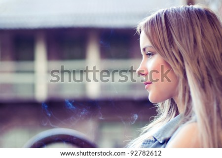portrait of a beautiful girl on the street in summer - stock photo