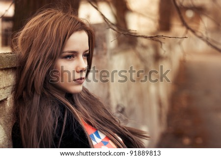 portrait of a beautiful girl on the street. photo with warm colors - stock photo